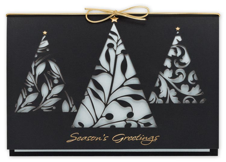 Beautiful black linen holiday card printed on recycled stock with a gold bow.