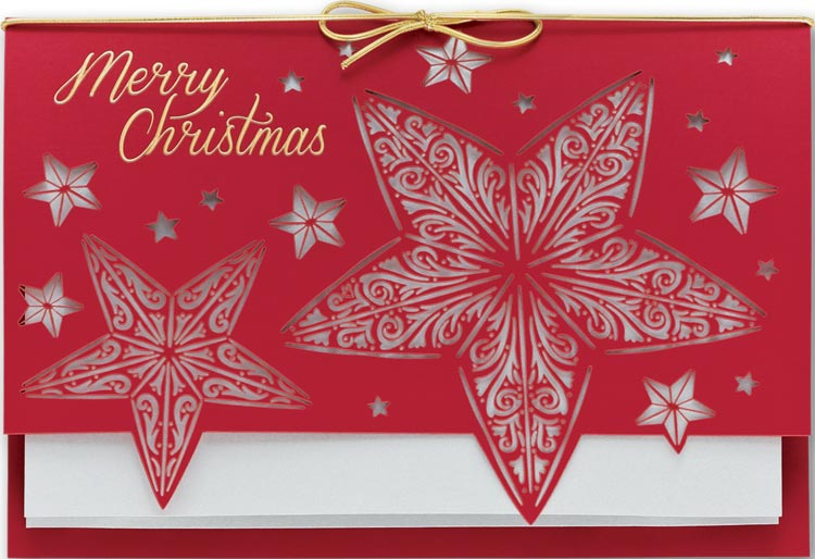 Laser cut holiday card with solver foil accents and a gold bow. Printed on 30% recycled fibers.