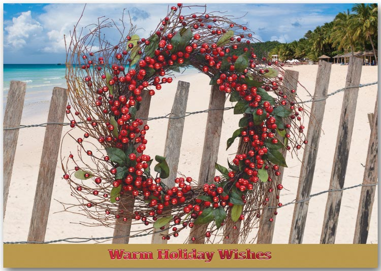 Tropical themed holiday greeting cards featuring a wreath on a white fence.