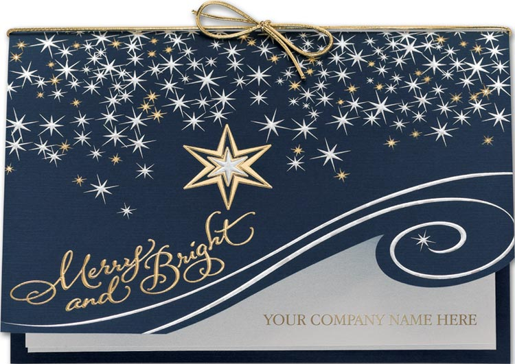 Holiday greeting cards printed on midnight blue linen stock with silver foil and a gold bow.