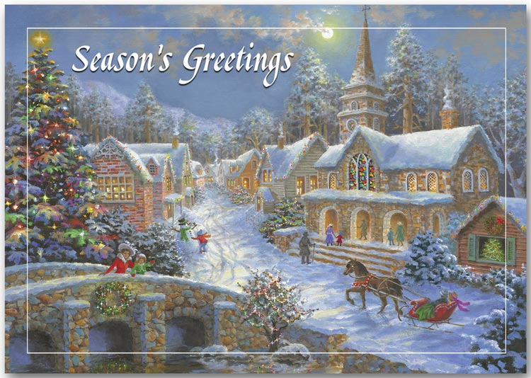 Holiday cards with a traditional village scene, horses, snow and lit homes.