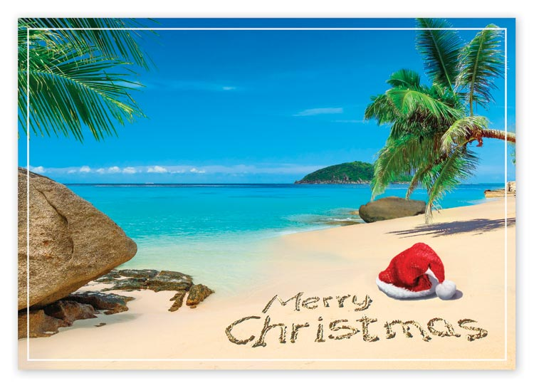 Personalized holiday card featuring Santa's hat on a sunny beach day for a tropical Christmas.