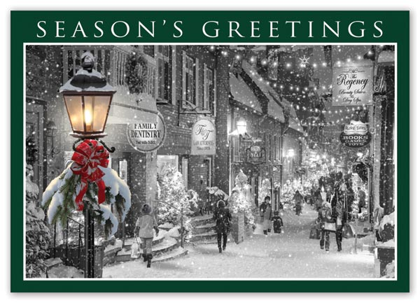 Budget holiday cards with nostalgic street glow images and imprinting options
