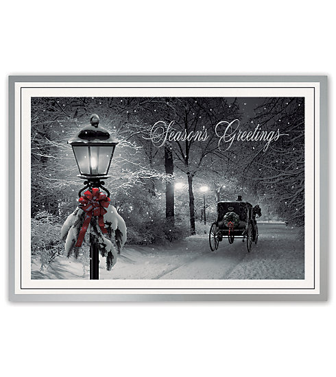 An inviting lamplight with horse and carriage adorn this card.